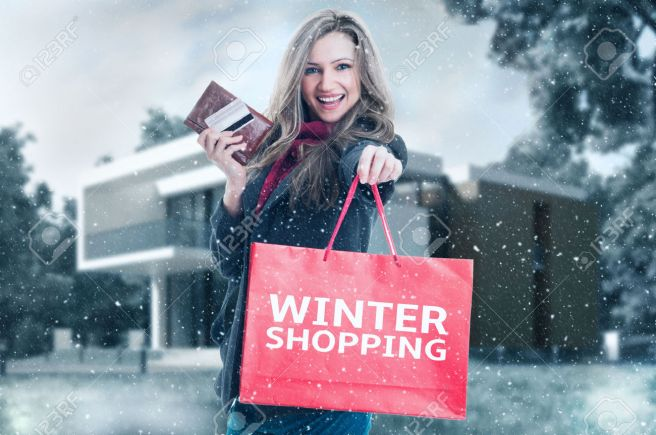 48325531-winter-shopping-woman-concept-with-snowing-outdoor-background-stock-photo